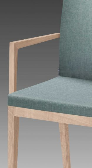 Handcrafted production of the solid wood armrests and bases made of selected European woods.